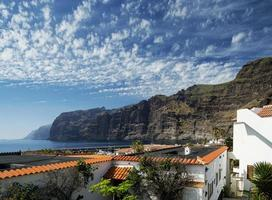Los Gigantes cliffs famous landmark and village in south Tenerife island Spain photo