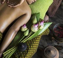 Asian massage spa natural organic beauty treatment with turmeric scrub paste photo