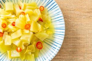 Spicy salad pickle cabbage or celery with sesame oil photo
