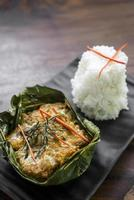 Traditional Cambodian Khmer fish amok curry meal photo