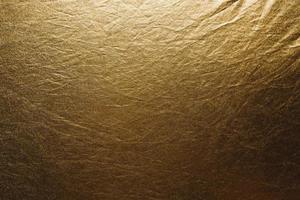 textura arrugada de tela dorada foto