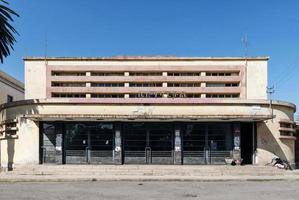 Italian colonial art deco old cinema building in Asmara Eritrea street photo
