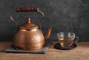 Group of Arabic tea in glass and metal tea pot photo