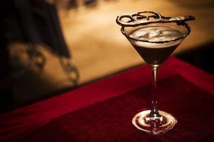 Chocolate martini cocktail drink in bar at night photo