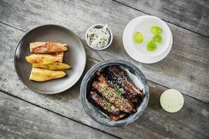 Pork ribs with thick potato fries coleslaw and garlic mayonnaise photo