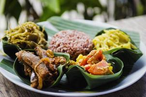 Vegetarian traditional curry and brown rice meal in Bali Indonesia photo