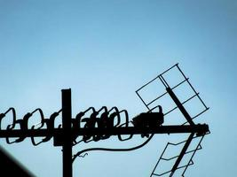 Television antennas with blue sky background photo