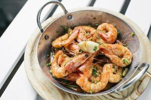 Portuguese garlic and herb boiled fresh prawns tapas snack set photo