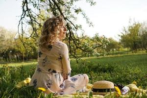 Beautiful woman, weekend out for a walk in a picnic park photo