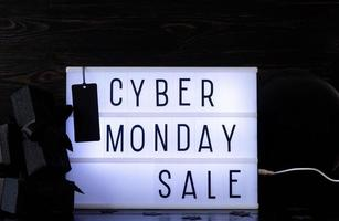 Cyber Monday Sale words on lightbox with black price tag photo