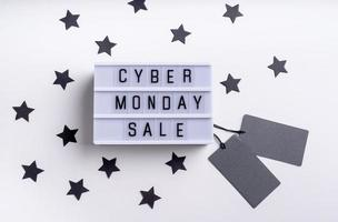 Cyber Monday Sale words on lightbox with black price tags photo