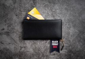 Black wallet with text Black Friday Sale on a tag and credit cards photo
