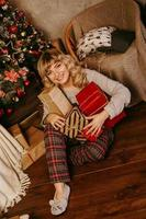 Cheerful blonde woman in the New Year decorations. Christmas time photo
