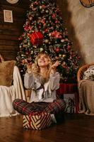 Woman throwing up a gift, concept of the new year, Christmas photo