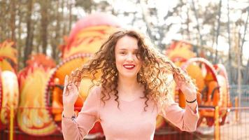 Girl chilling in amusement park in morning. Laughing female model photo