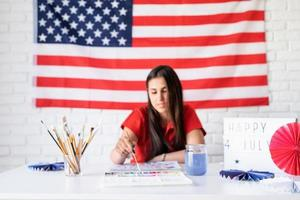 Woman drawing a watercolor illustration for Independence day of the US photo