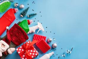 Cleaning tools and materials in Christmas stocking, top view, flat lay photo