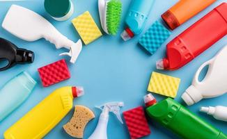 Collection of various sanitary bottles and cleaning tools photo