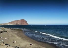 Las Tejitas volcanic beach and Montana Roja landmark landscape in south Tenerife Spain photo