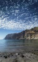 Los Gigantes cliffs natural famous landmark and volcanic black sand beach in south Tenerife island Spain photo