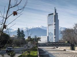 Downtown street in Santiago de Chile city and Andes mountains view photo