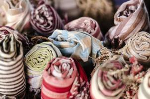 Mixed traditional krama cotton scarf souvenirs detail on display at shop in Angkor Wat in Cambodia photo