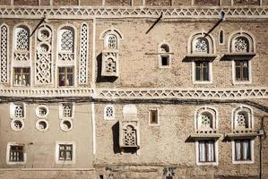 Traditional Yemeni heritage architecture design details in historic Sanaa old town buildings in Yemen photo