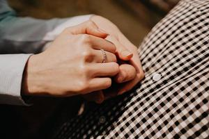 Hands of couple. Couple of lovers holding hands photo