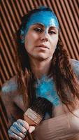 Portrait of beautiful girl with blue bodyart with sequins photo