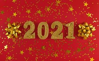 Greeting card of New Year 2021. Golden glittered figures, stars photo