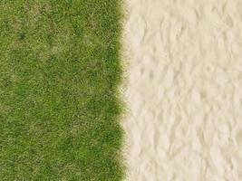 Beach sand and green grass photo