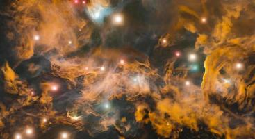 Golden nebula background with bright stars photo