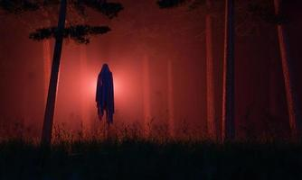 Ghost of the evil spirit in a mysterious foggy forest photo