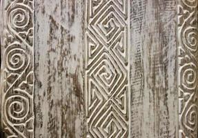 Tallado a mano en madera de estilo tradicional de Bali para arte mural. foto