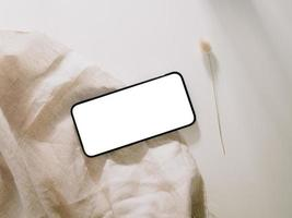 Smartphone mockup with phone with blank screen template, flat lay photo