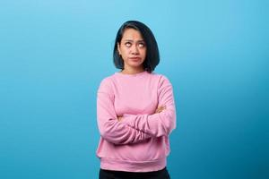 Portrait of beautiful young Asian woman with crossed arms photo