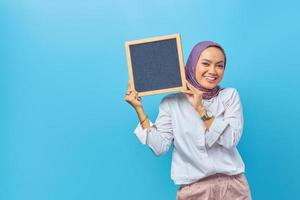 Portrait of Asian woman holding board with smiling expression photo