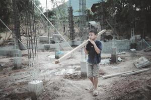 Children working at construction site. photo