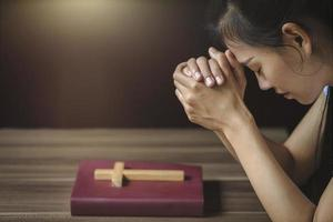 Religious young woman praying to God in the morning. photo