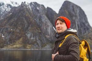 Portrait traveler man on background of mountain and lake photo