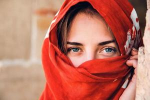 Woman with blue eyes in traditional Islamic cloth photo