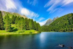 The alpine lake in the Swiss Alps of Palpuogna below the Albula pass photo