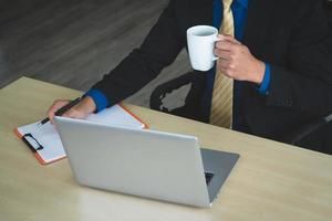 Businessman using computer in the office photo