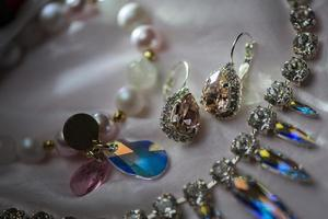 Close up details of necklace and earrings with swarovski crystal stone photo