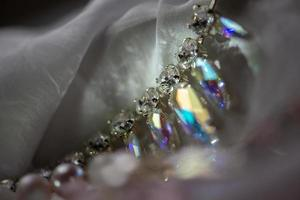 Close-up details of necklace and earrings with swarovski crystal photo
