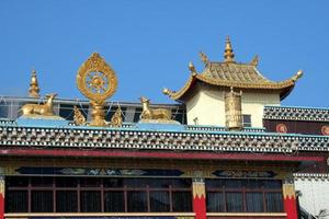 Top exterior of Buddhist Temple photo