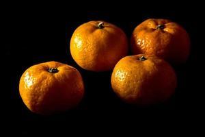 Glossy surface texture of freshness orange fruits photo