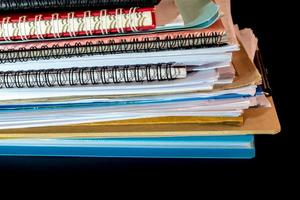 Stacked of office documents paper in the black background photo