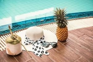 Summer Vacation and Swimming Pool Relaxation Lifestyles Concept photo