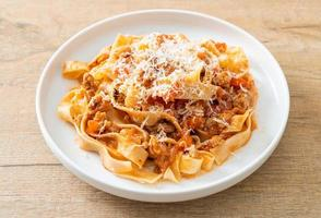 Homemade pasta fettuccine bolognese with cheese photo